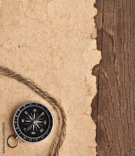 compass and rope on wood background