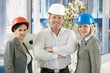 Confident professionals wearing hardhat