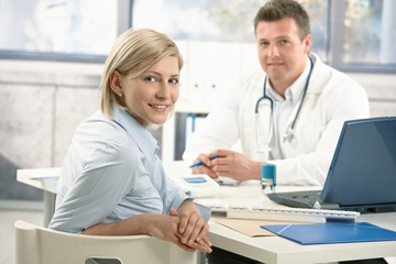 Smiling woman in doctor's office