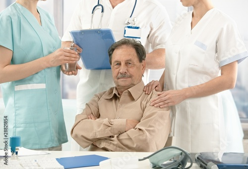 Old patient sitting on doctor's room