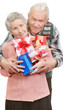 old couple and boxes with gifts