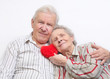 happy old couple with red heart
