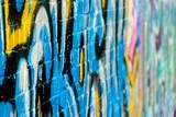 Abstract graffiti closeup on the textured brick wall - 28825829