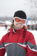 Young woman in ski goggles and sports jacket