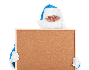 Blue santa claus and part of empty bulletin board