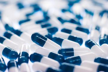 Blue pills on white. Very small focus range.