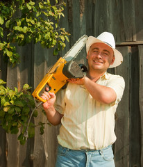 gardener posing  with his chainsaw