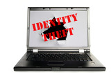 Laptop with a hole torn and Identity Theft text poster