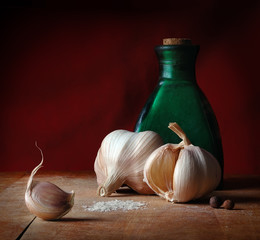 Still life with garlic, salt and allspice