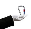 Hand holding carabiner