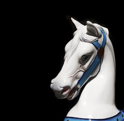 White Carousel Horses Head on Black Background