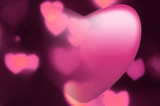 Pink heart fades into out-of-focus heart light background