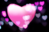 Pink heart blurs into out-of-focus heart-light background