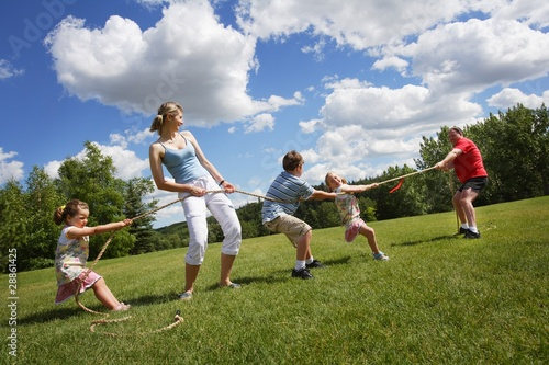 Tug Of War Between Dad And Mom With Kids