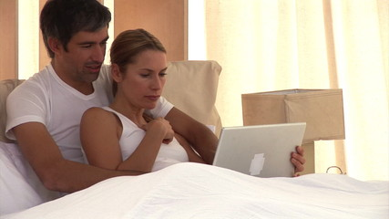 Happy couple doing shopping online