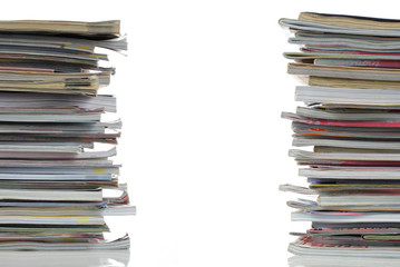 stack of magazines over white background