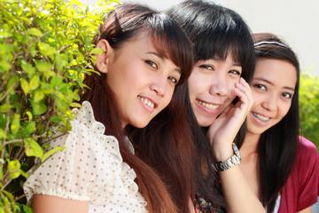 three best friend smiling outdoor
