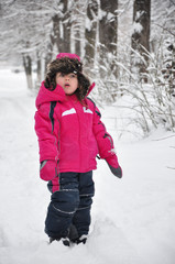 Cute toddler girl in winter forest