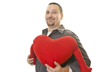 man with a smile holding heart for Valentine Day