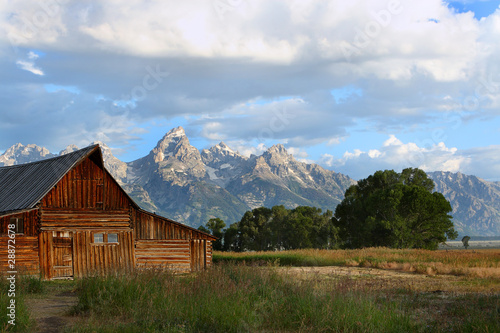 Sunrise on the Tetons Mountain range with the Mormon barn
