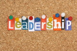 The word Leadership in magazine letters on a notice board poster