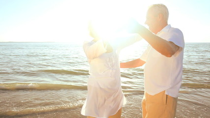 Romantic Seniors Dancing on the Beach