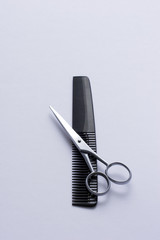 Scissor and comb on white, slightly blue toned.