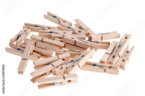 Wooden clothespins on white background