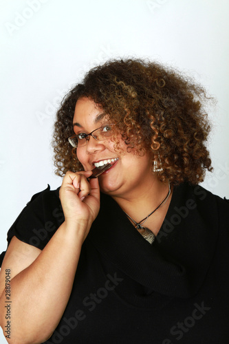 Smiling Woman Eats Dark Chocolate