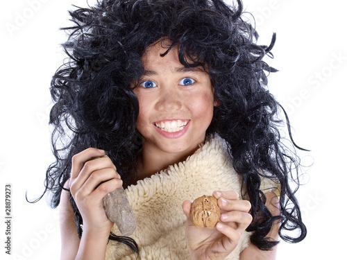 Leinwanddruck Bild neandertaler kind mit walnuss und stein