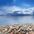 A beautiful coast image with sky, water and stones