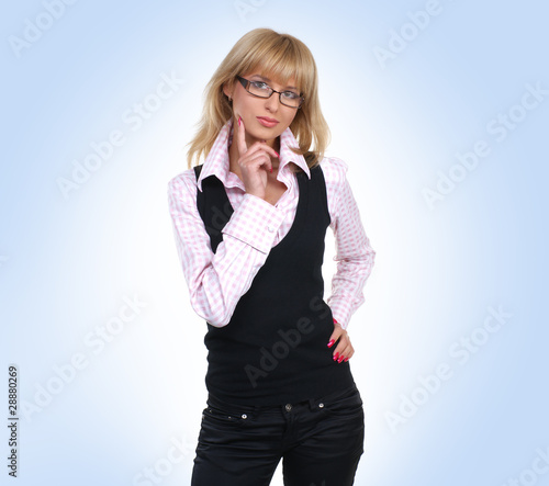 A young and happy blond businesswoman in formal clothes