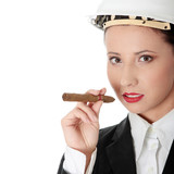 Businesswoman (boss) with cigar (feminism concept)