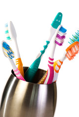 Toothbrushes in metal cup