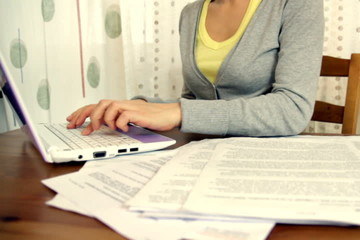 Woman working on her bills