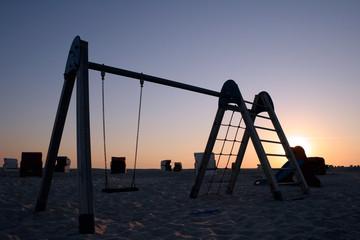 Empty beach playground at sunset