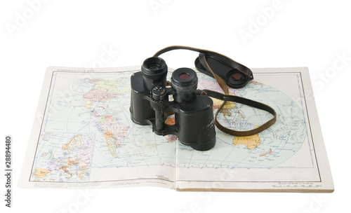 old commander's binoculars with a map