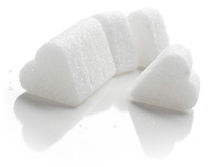 White Sugar in heart shape. Isolated on white.
