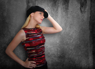Club Girl Holding Hat on Grunge Background