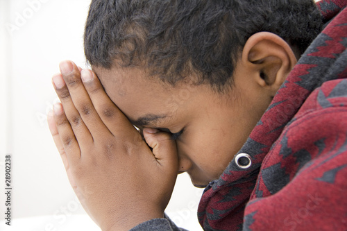 A Young kid praying