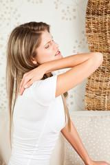 Young, beautiful  woman with backache