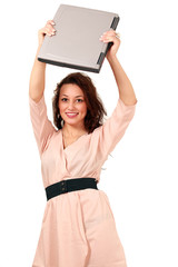 Smiling female raises laptop, technology on the move