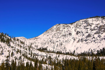 Snow wild mountains and blue sky