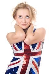 smiling blonde wearing union-flag shirt