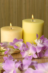 relaxing spa with candles and orchids