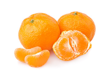 Ripe tangerines with slices isolated on white background