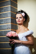 Happy bride with bouquet of flowers