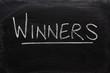 The word Winners on a used blackboard