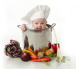 Licking baby sitting in a chef's pot - 28935694