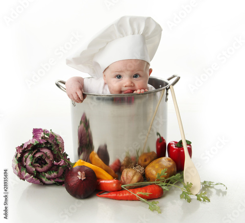 Fototapety, obrazy : Licking baby sitting in a chef's pot